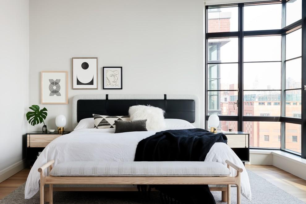 Bedroom - scandinavian master light wood floor bedroom idea in New York with white walls and no fireplace