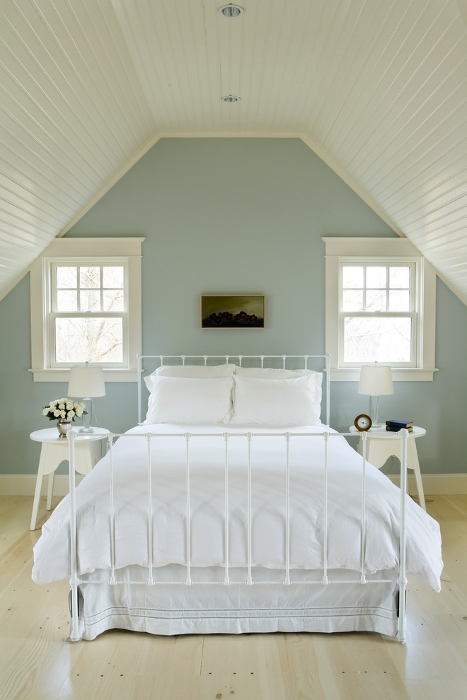Beach style light wood floor and beige floor bedroom photo in Providence with blue walls
