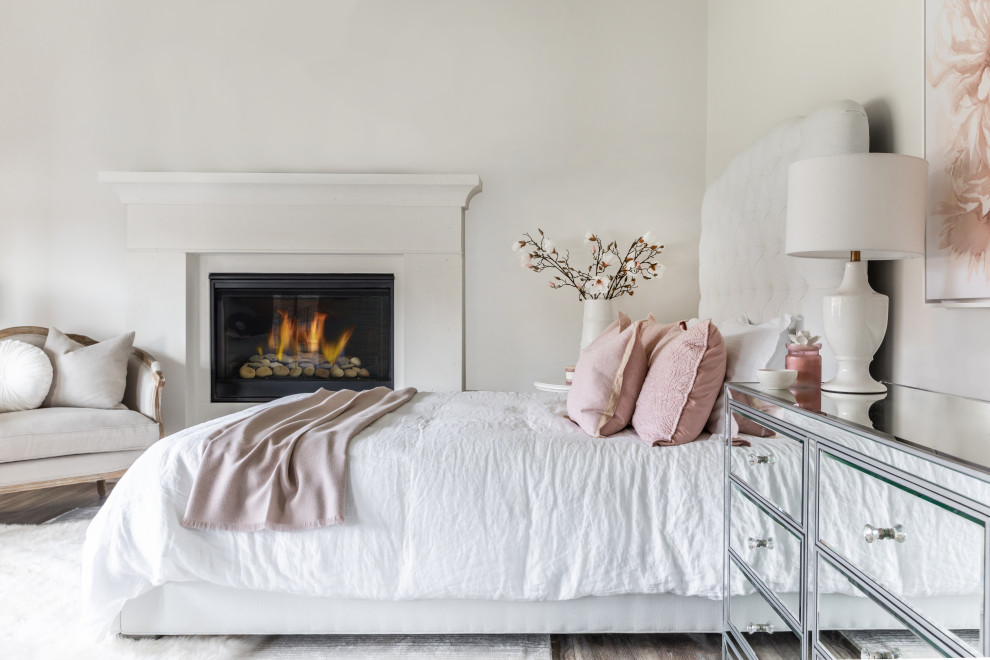 Beach style dark wood floor and brown floor bedroom photo in Charlotte with white walls and a standard fireplace