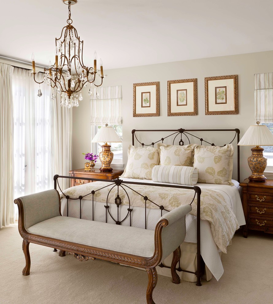 Inspiration for a timeless master carpeted bedroom remodel in Denver with beige walls