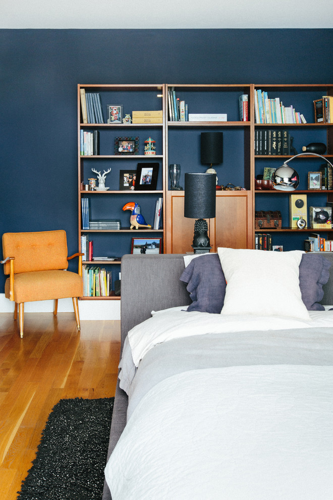 Trendy master light wood floor bedroom photo in San Francisco with blue walls