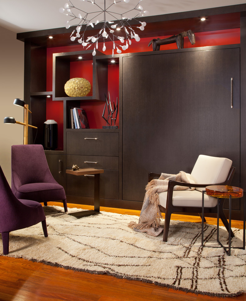 Example of a small trendy master medium tone wood floor bedroom design in Denver with red walls and no fireplace
