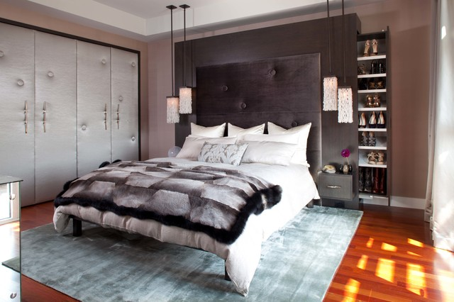 Bedroom - large contemporary master medium tone wood floor and brown floor bedroom idea in Denver with brown walls and no fireplace
