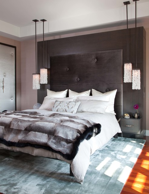 Bedroom - large contemporary master medium tone wood floor bedroom idea in Denver with brown walls and no fireplace
