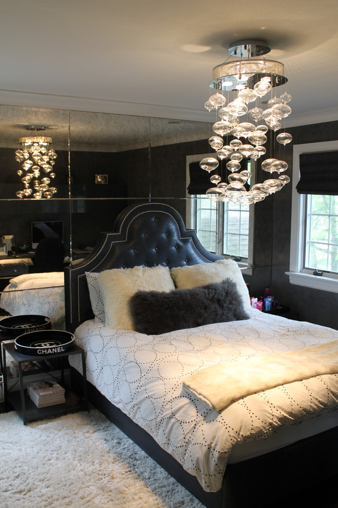 Example of a mid-sized cottage chic guest carpeted bedroom design in New York with black walls