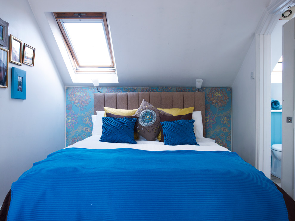Inspiration for a small contemporary bedroom remodel in London with multicolored walls