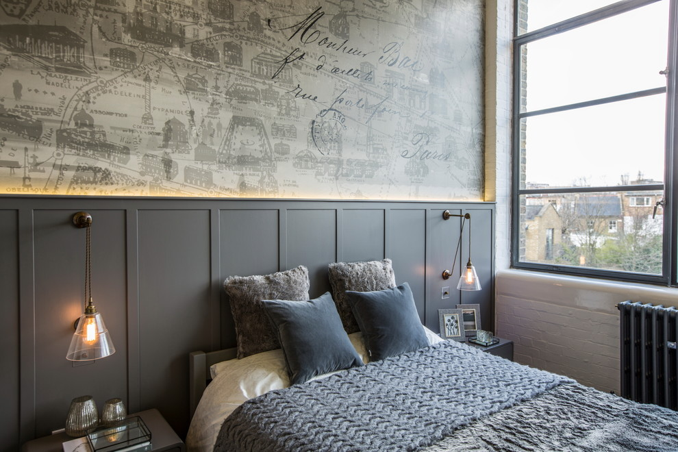 Design ideas for a large urban master loft bedroom in London with grey walls.
