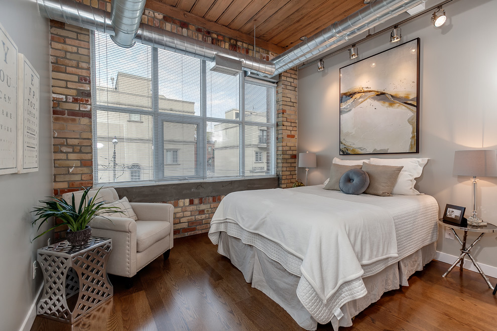 Inspiration for an industrial bedroom remodel in Toronto with gray walls