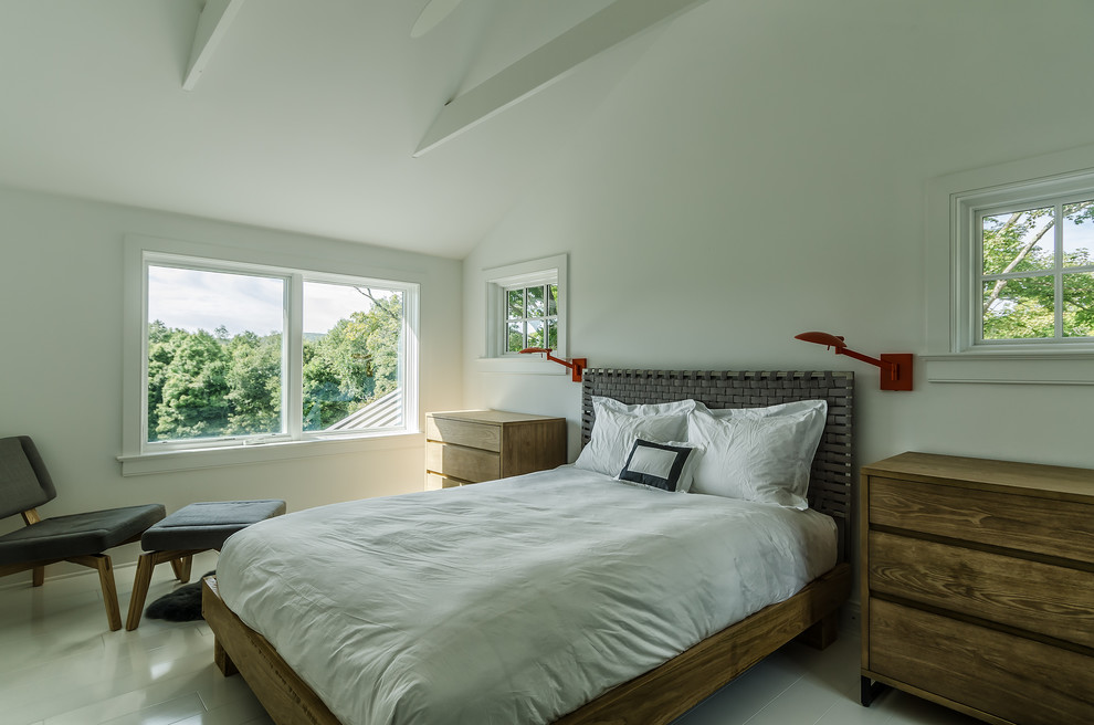 Bedroom - mid-sized cottage bedroom idea in New York with white walls