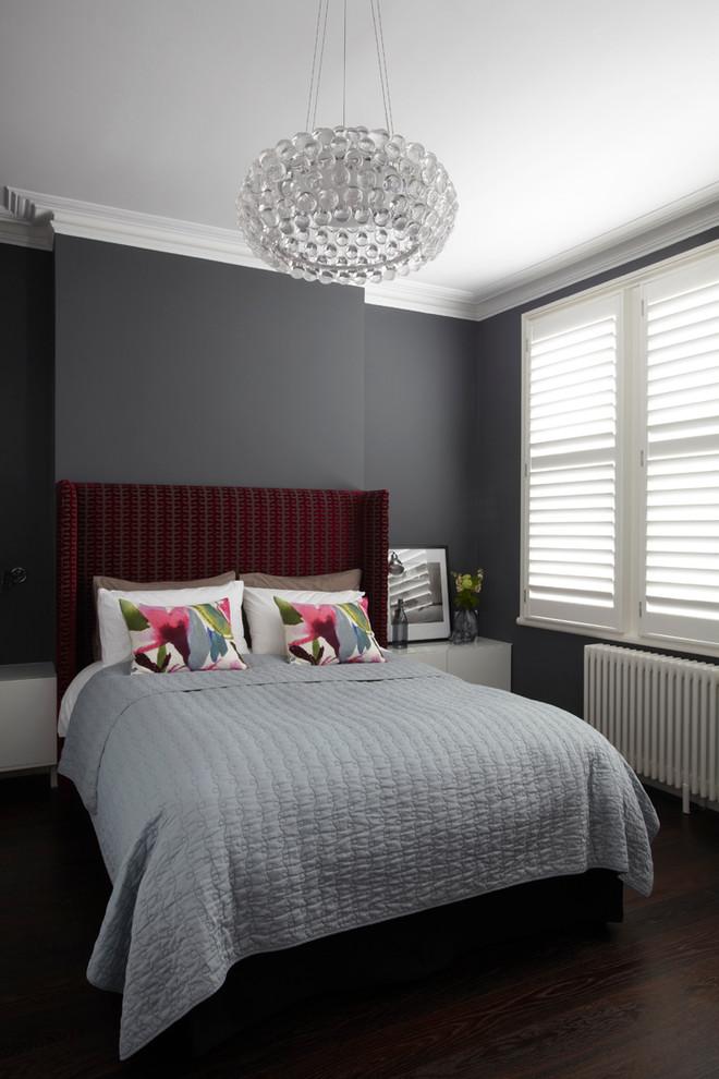Bedroom - contemporary bedroom idea in London with gray walls