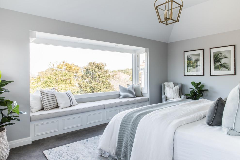 Beach style bedroom in Sydney with grey walls, carpet and grey floor.