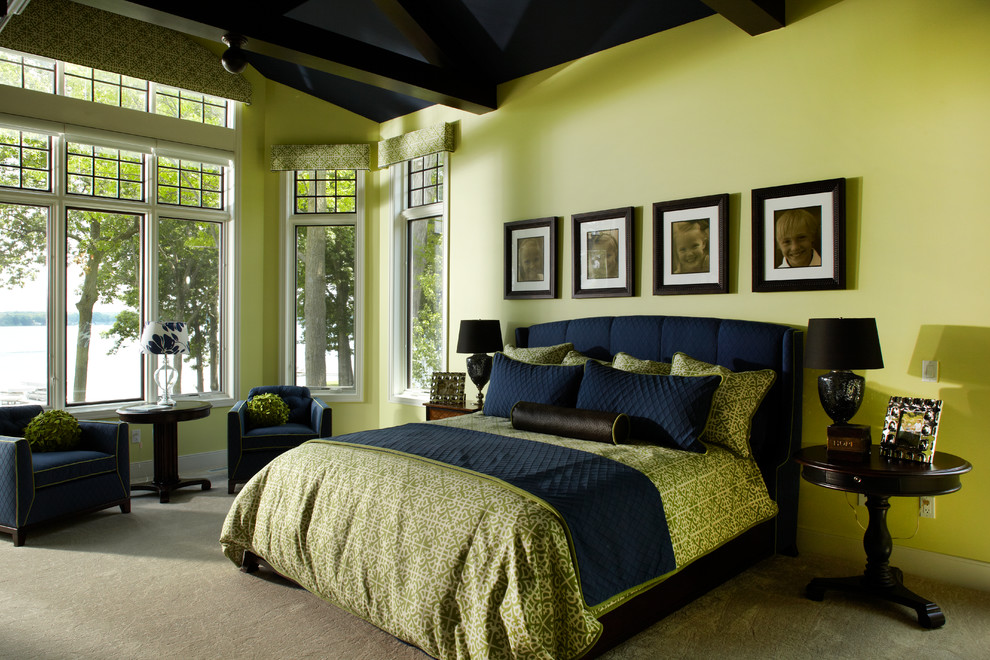 Inspiration for a timeless carpeted bedroom remodel in Grand Rapids with yellow walls and no fireplace