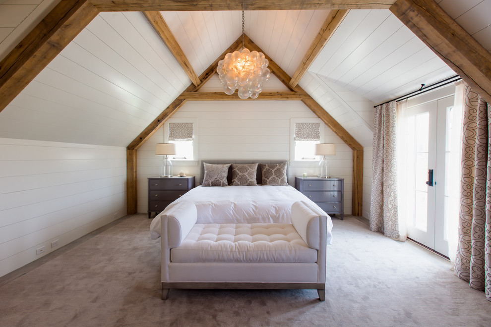 Inspiration for a large beach style master carpeted bedroom remodel in Boston with white walls