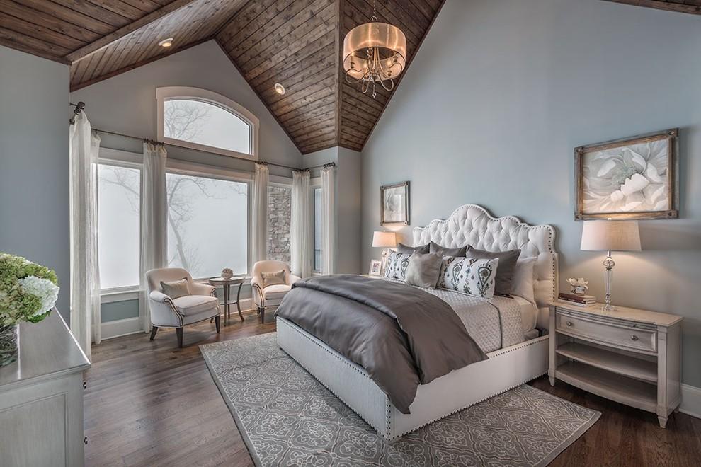 Large elegant master dark wood floor bedroom photo in Other with blue walls