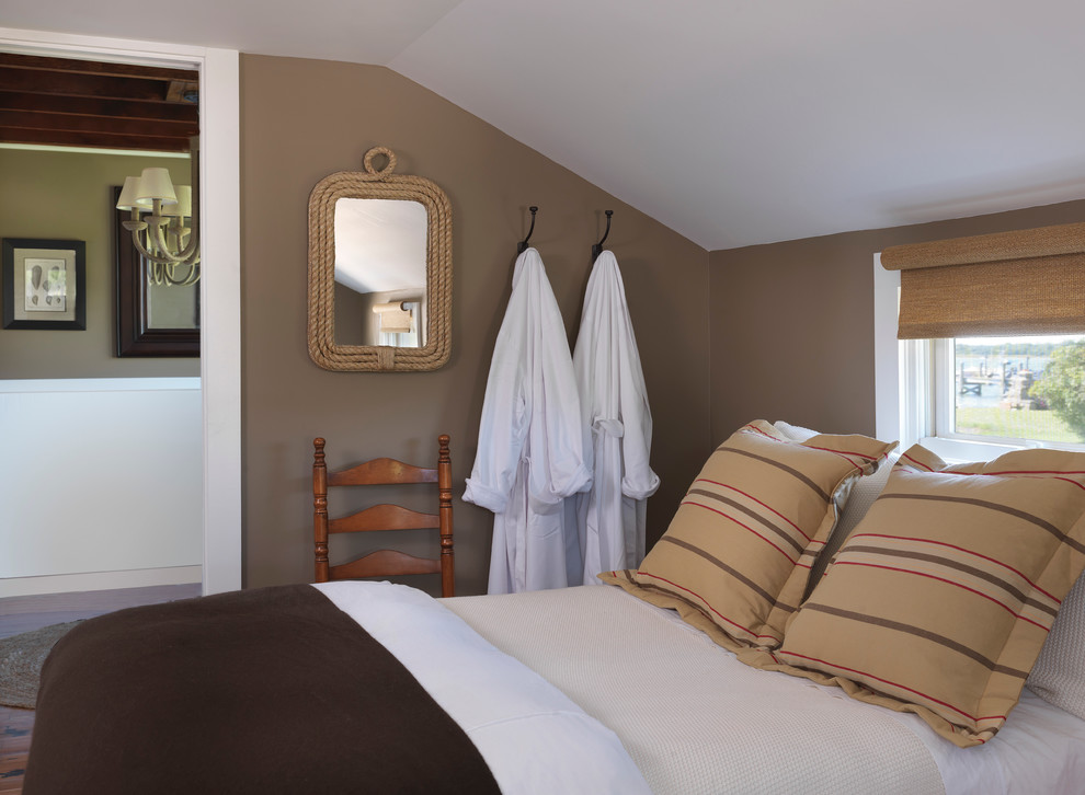 Beach style bedroom photo in Providence with brown walls