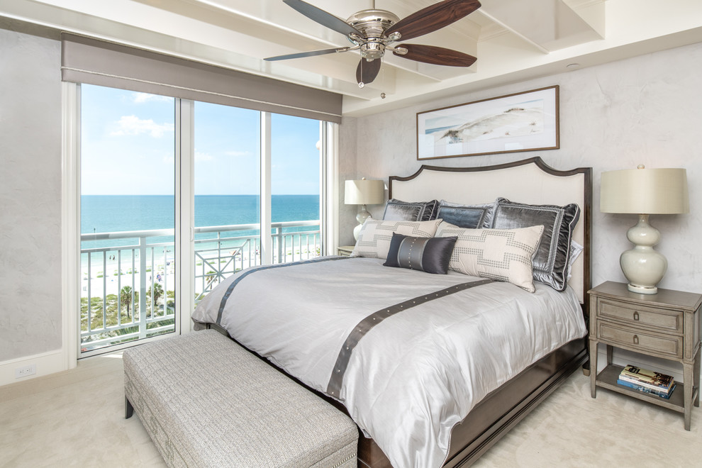 Coastal guest carpeted and beige floor bedroom photo in Tampa with gray walls