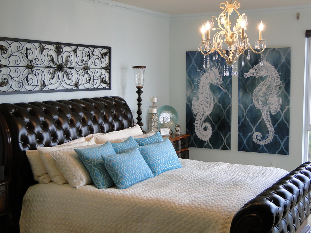 Example of a coastal bedroom design in Tampa