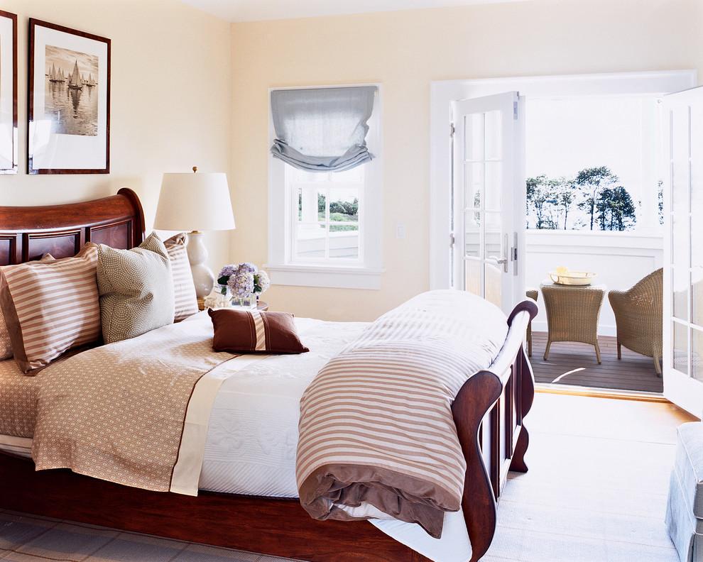 Example of a beach style medium tone wood floor bedroom design in Boston with beige walls