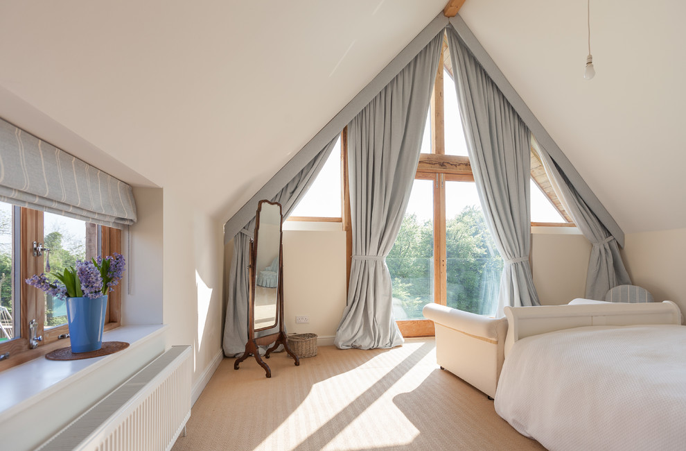 Trendy carpeted bedroom photo in Gloucestershire with white walls