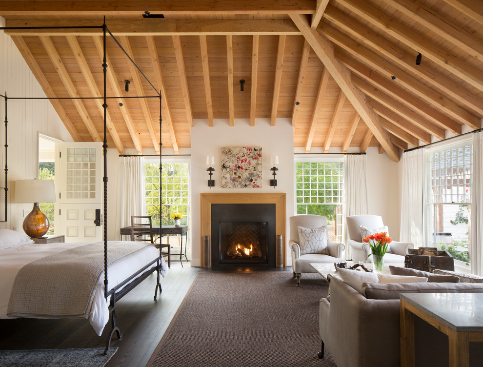 Inspiration for a cottage dark wood floor bedroom remodel in San Francisco with white walls and a standard fireplace