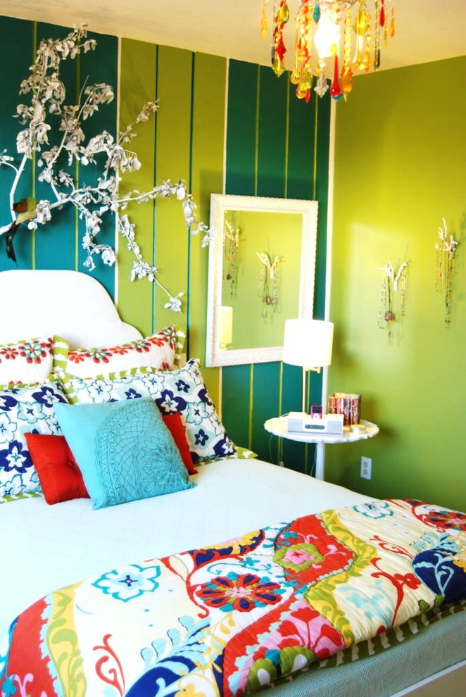 Example of an eclectic bedroom design in Boise with green walls