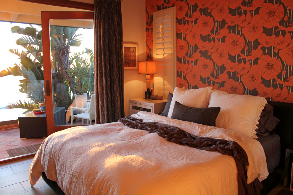 Inspiration for an eclectic bedroom remodel in San Diego with orange walls
