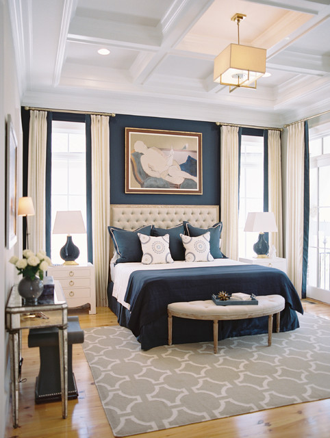Photo of a classic bedroom in Other with blue walls and medium hardwood flooring.