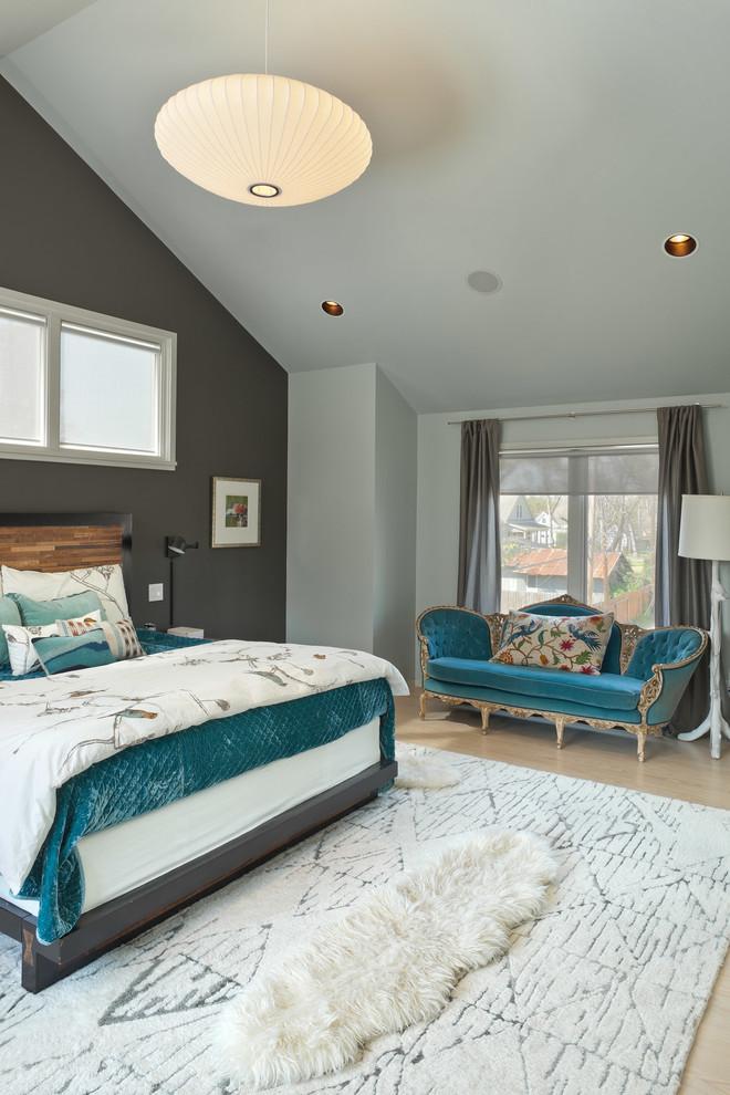 Example of a trendy master light wood floor bedroom design in Houston with gray walls