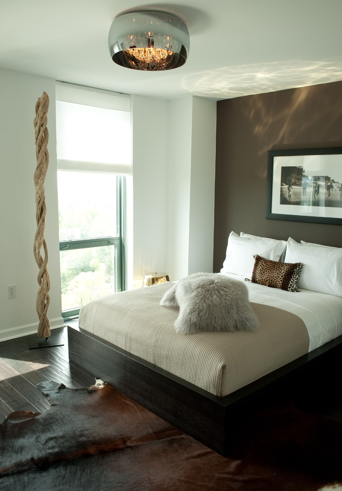 Inspiration for a mid-sized contemporary master dark wood floor bedroom remodel in Atlanta with brown walls