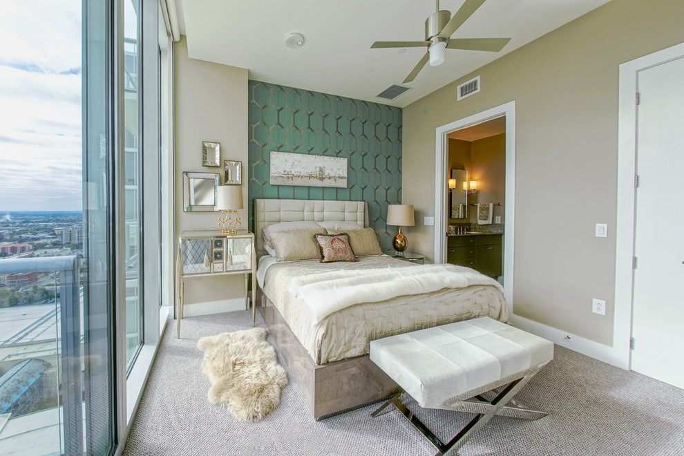 Example of a small transitional master carpeted bedroom design in Austin with green walls