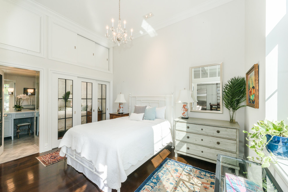 Inspiration for a mid-sized cottage master dark wood floor and brown floor bedroom remodel in Boston with white walls and no fireplace