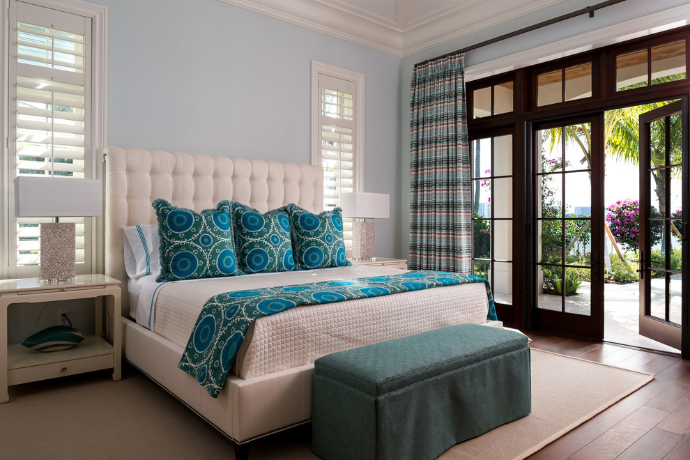 Inspiration for a transitional master medium tone wood floor bedroom remodel in Miami with blue walls