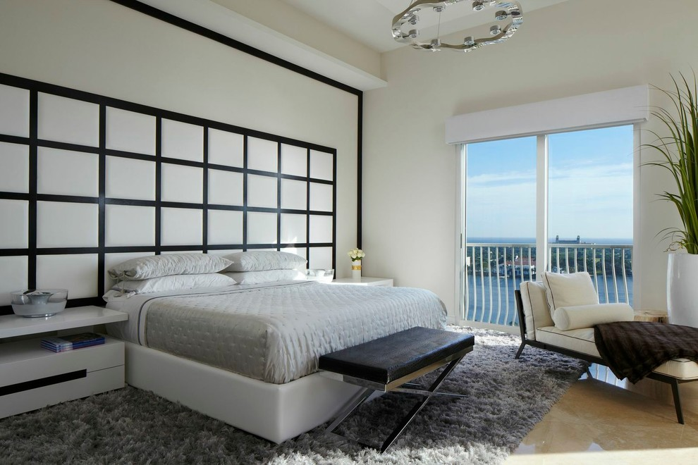 Trendy master bedroom photo in Miami with white walls and no fireplace