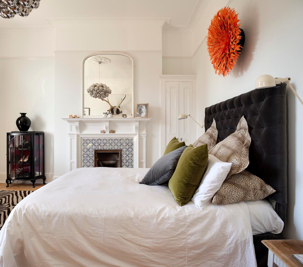 Inspiration for a contemporary bedroom remodel in Other with white walls, a standard fireplace and a tile fireplace