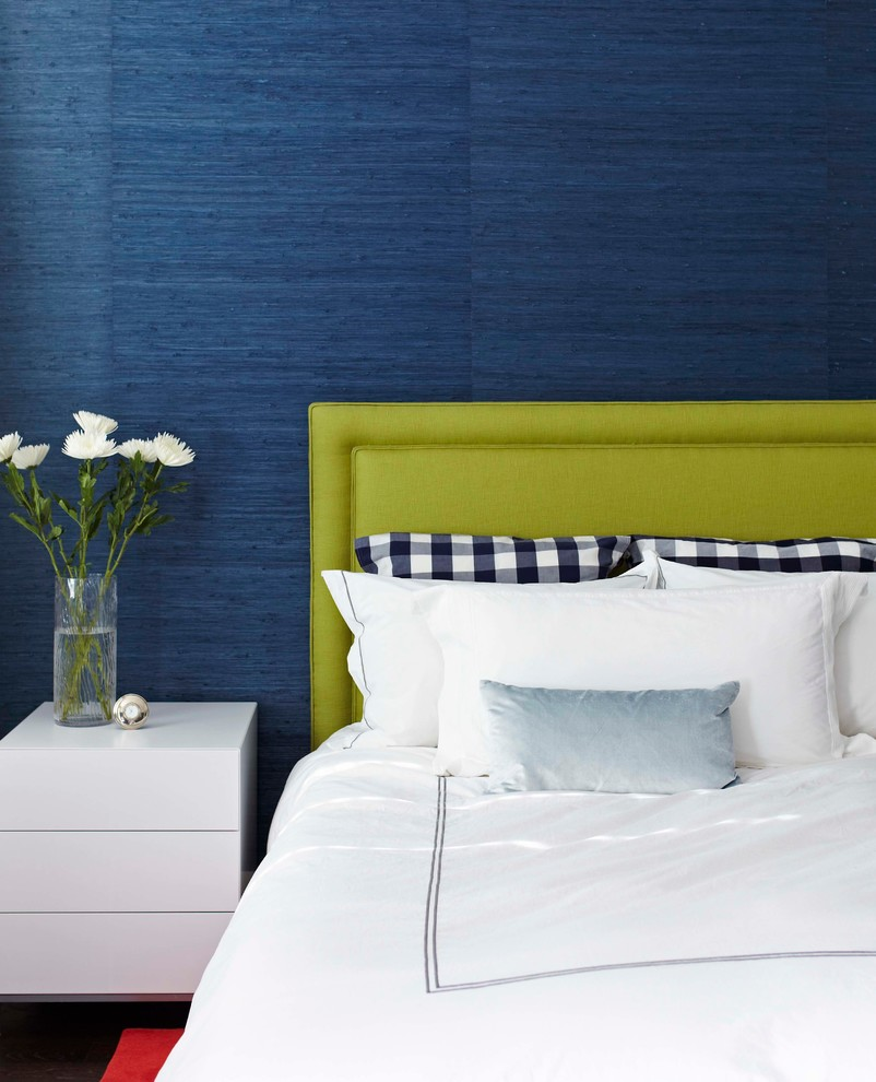 Example of a trendy bedroom design in Toronto with blue walls