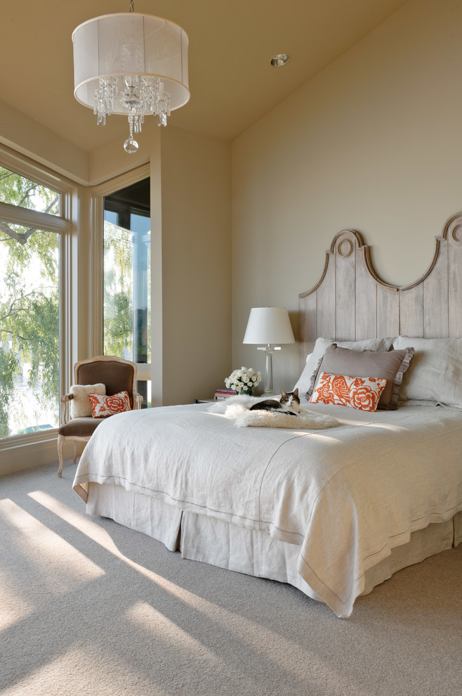 Trendy carpeted bedroom photo in Seattle with beige walls and no fireplace