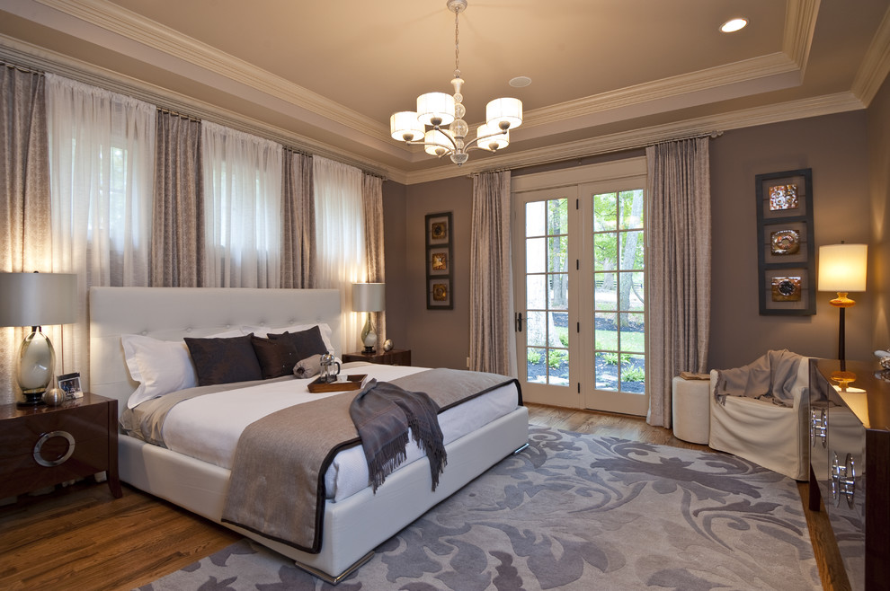 Inspiration for a contemporary medium tone wood floor bedroom remodel in Other with gray walls