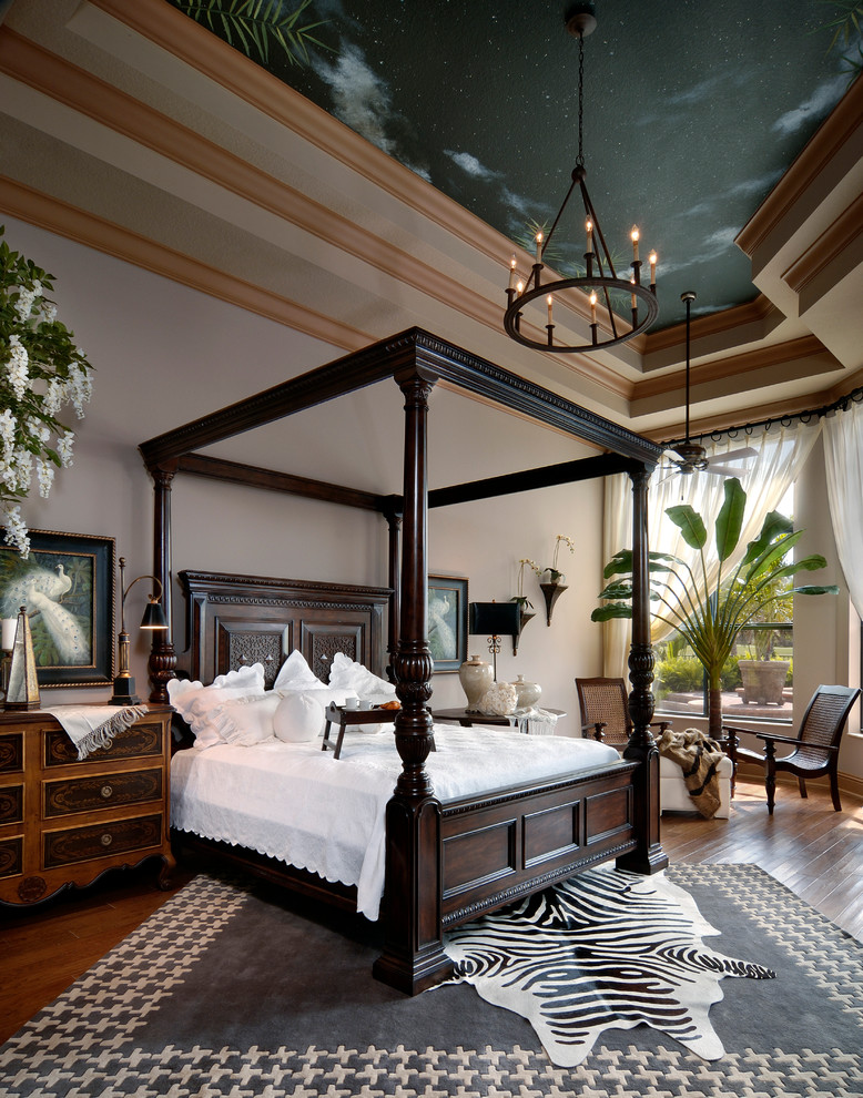 Example of a trendy master medium tone wood floor bedroom design in Miami with white walls and no fireplace