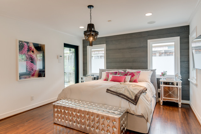 Example Of A Trendy Medium Tone Wood Floor Bedroom Design In Los Angeles  With White Walls