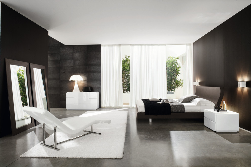 Example of a trendy bedroom design in Other with black walls