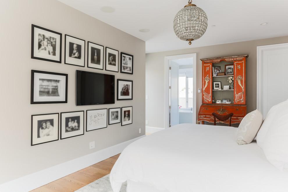 Bedroom - contemporary light wood floor bedroom idea in San Francisco with beige walls