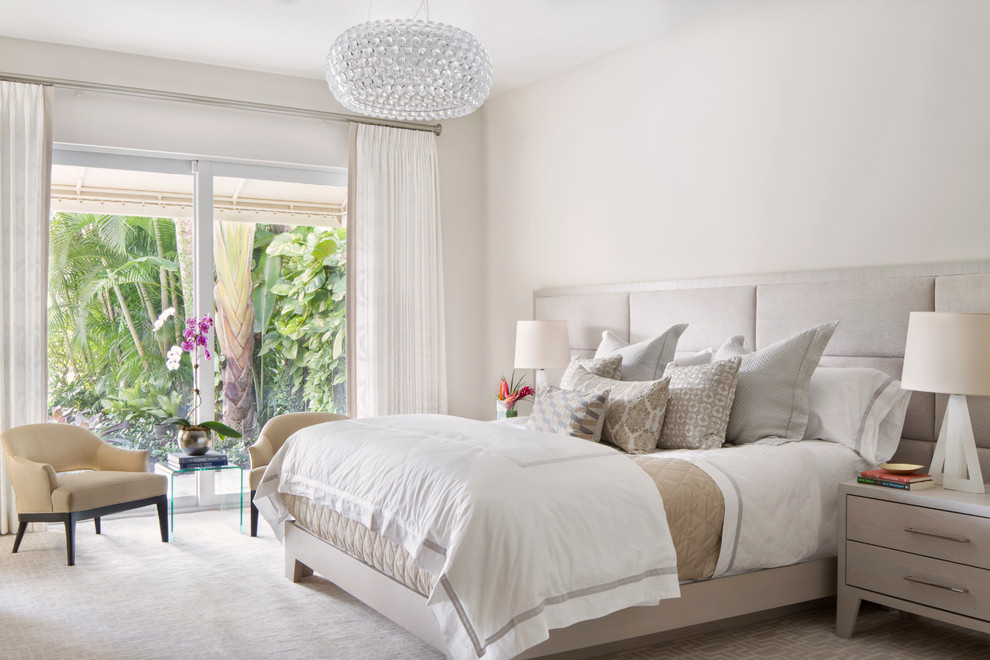 Bedroom - mid-sized contemporary master carpeted bedroom idea in Miami with white walls