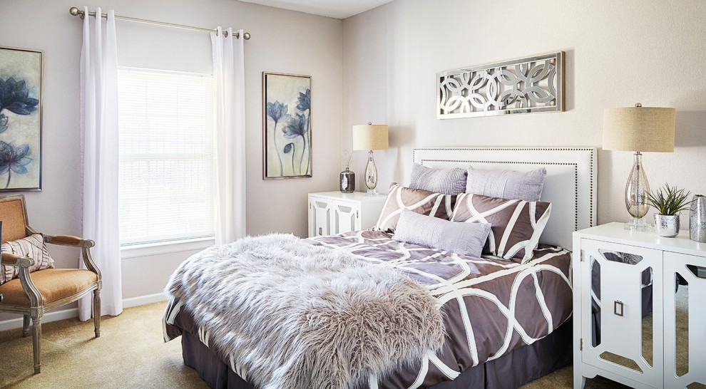 Example of a trendy carpeted bedroom design in Kansas City with gray walls
