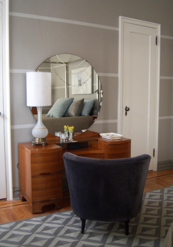 Bedroom - contemporary medium tone wood floor bedroom idea in Other with beige walls