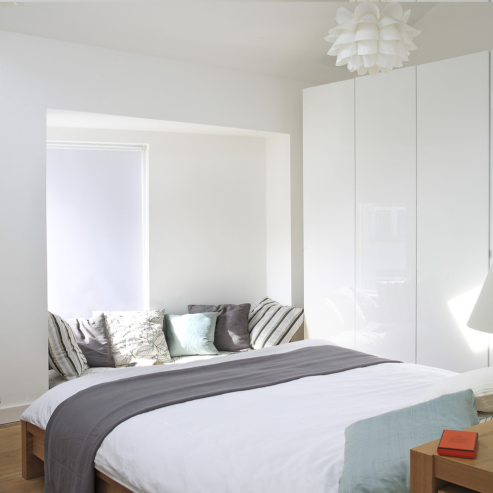 Inspiration for a contemporary master bedroom remodel in Dublin with white walls