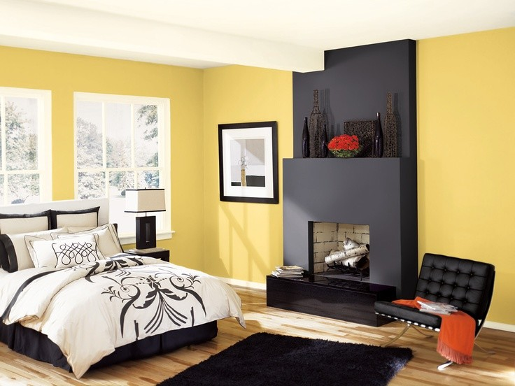 Inspiration for a contemporary master light wood floor bedroom remodel in Vancouver with yellow walls