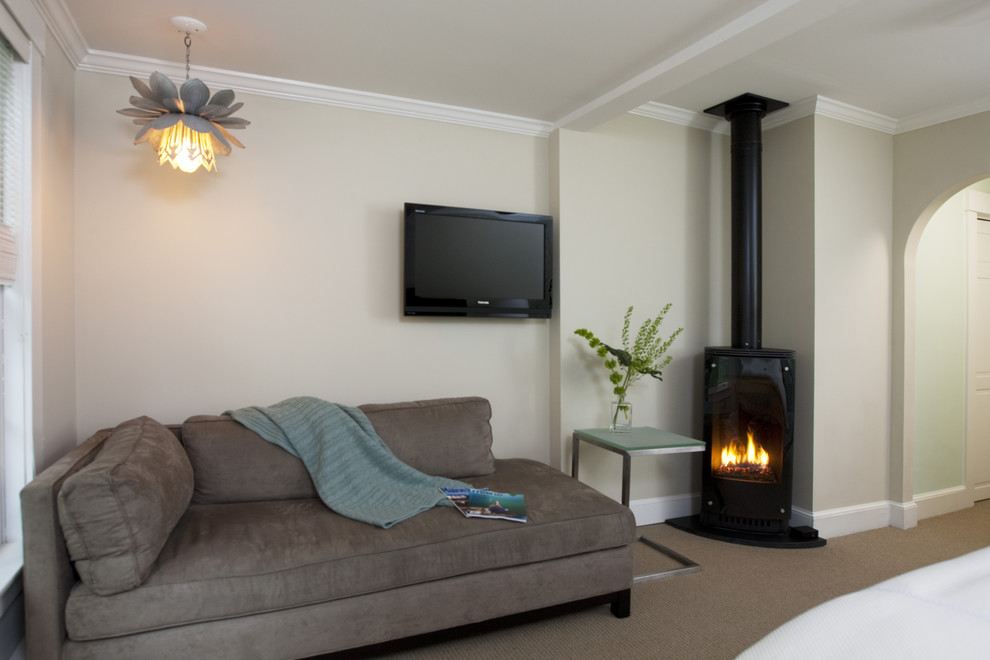 Example of a trendy bedroom design in Boston with a wood stove