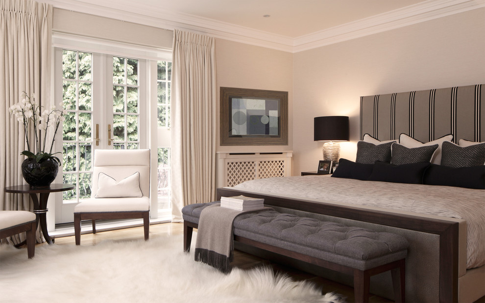 Bedroom - contemporary bedroom idea in London with gray walls