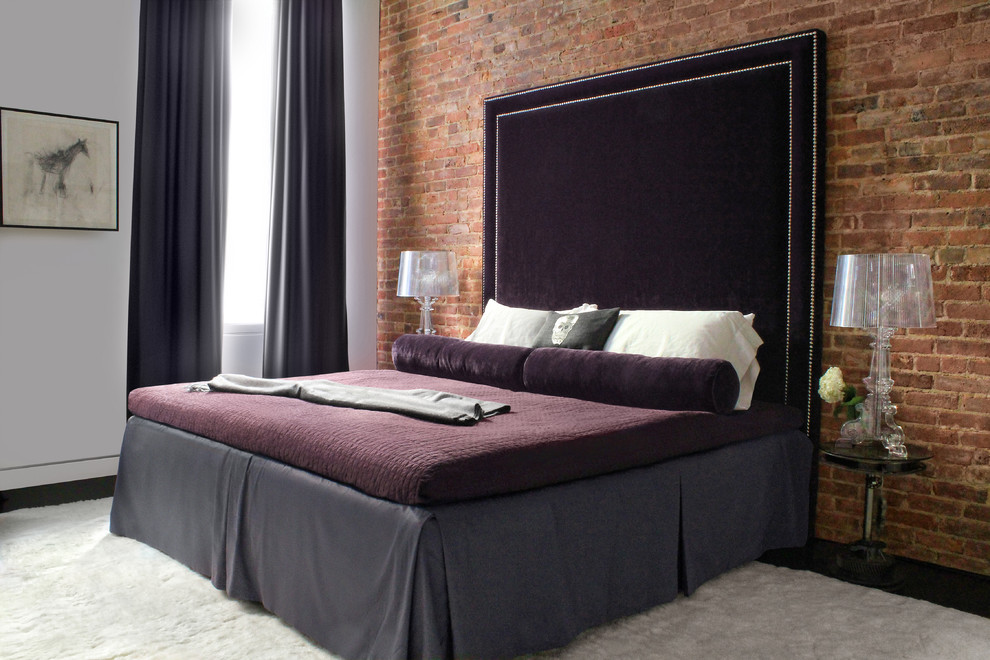 Example of a trendy dark wood floor bedroom design in New York with white walls and no fireplace