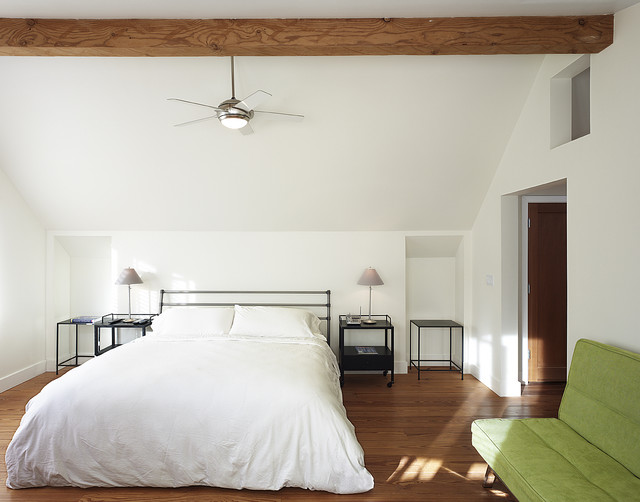 Example Of A Trendy Medium Tone Wood Floor Bedroom Design In Other With  White Walls